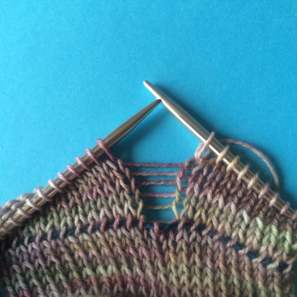 catching a dropped stitch in your knitting