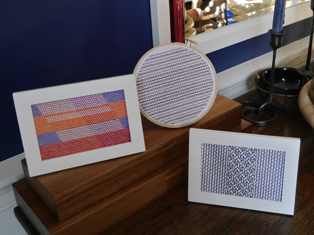 three pieces of embroidery