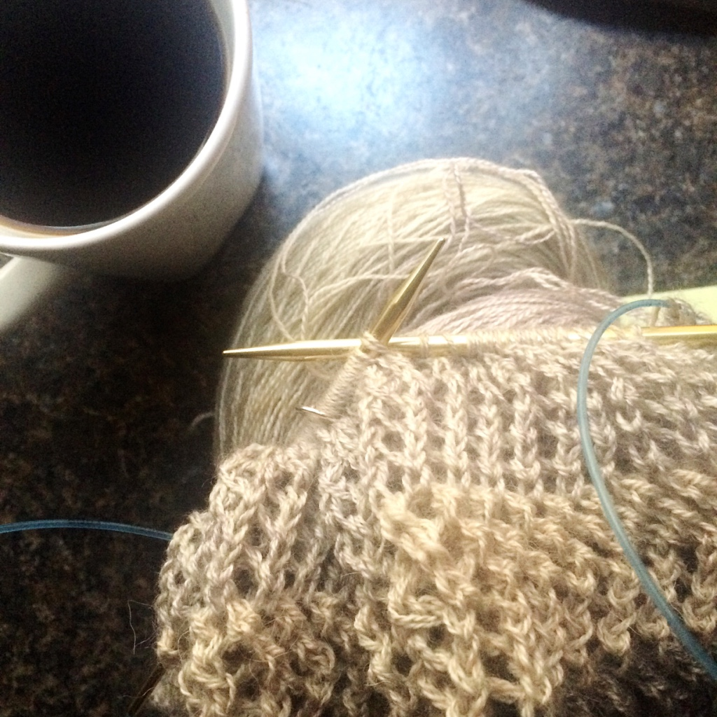 knitting a lace sweater over coffee